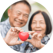 A senior couple holding a heart shaped object together